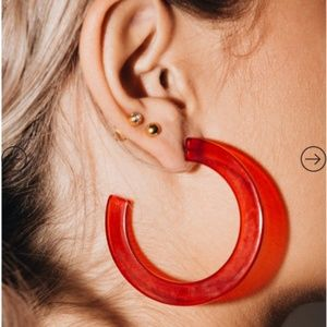 RED OPEN HOOP EARRINGS